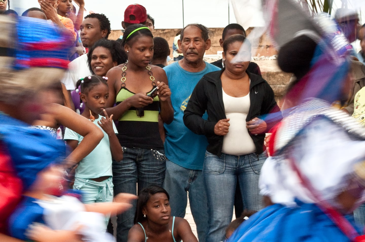 dominican family watching parade