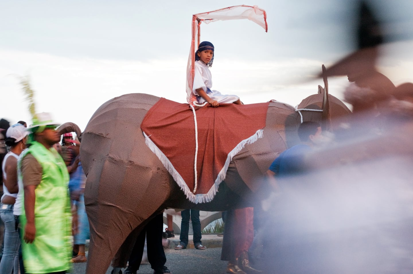 boy riding elephant in costume