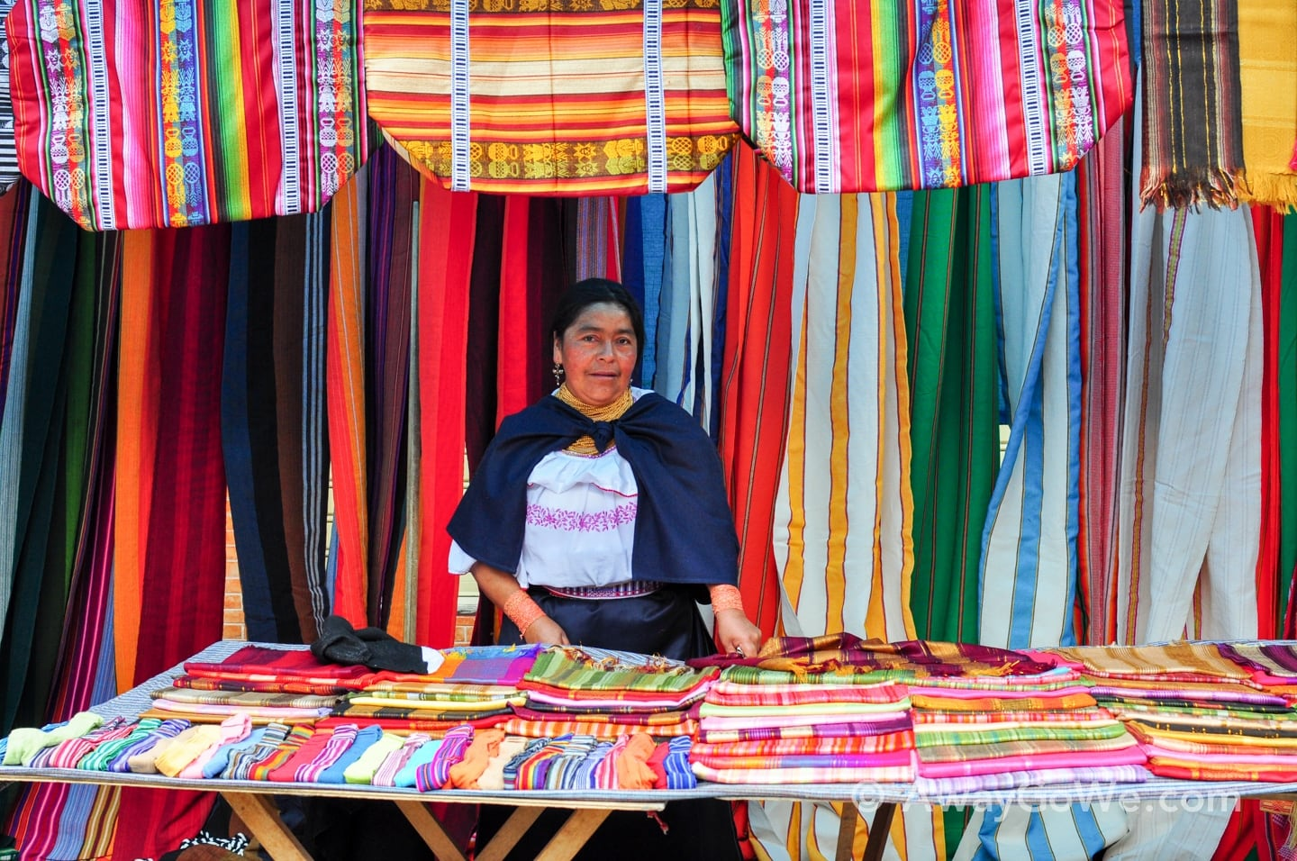 Andean woman and colorful textiles