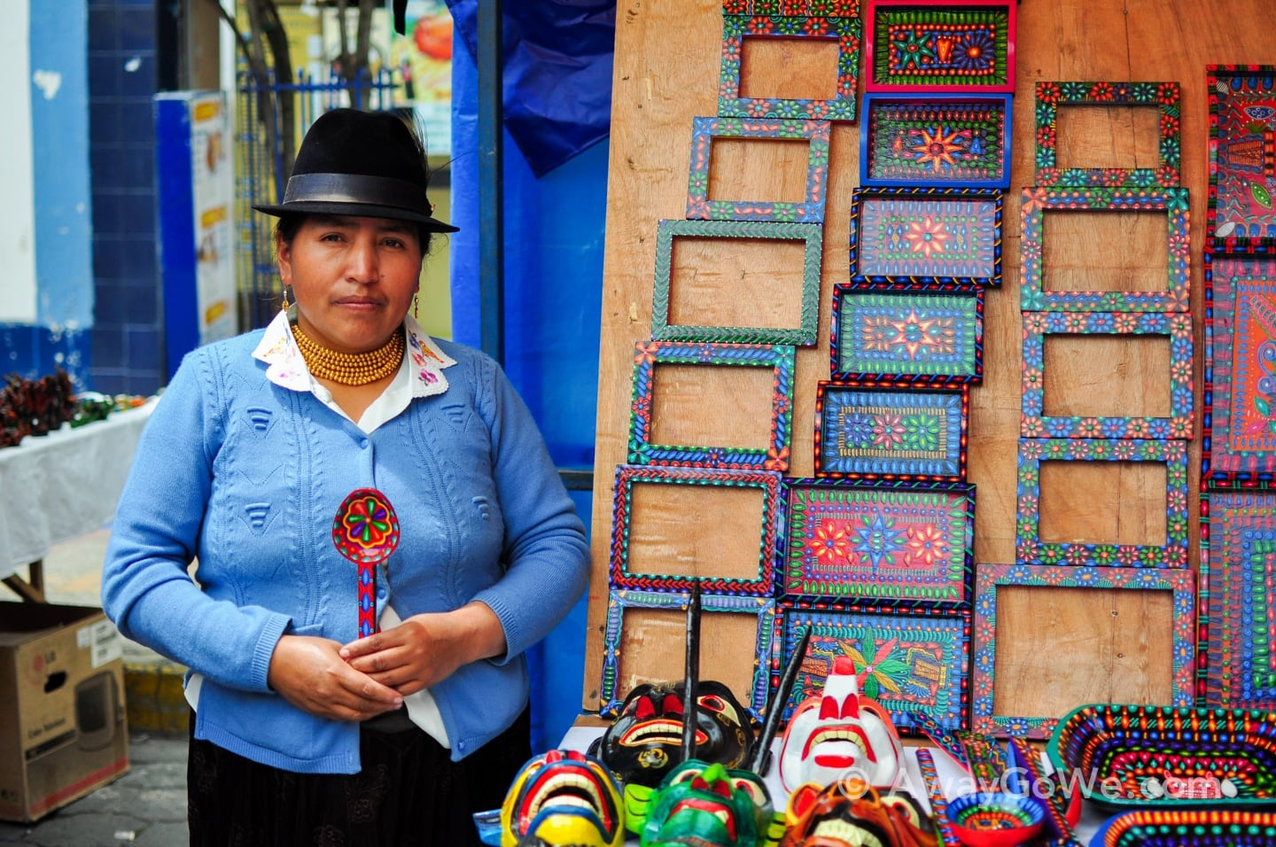 Andean woman with painted handicrafts