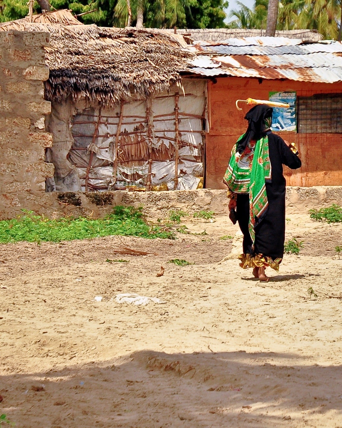 woman walking with umbrella Shela Lamu