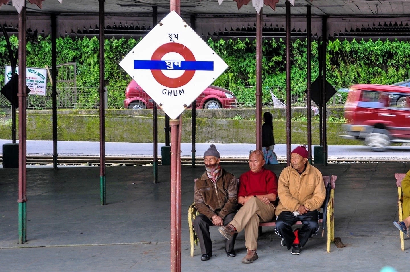 three men wait at Ghum Darjeeling Toy Train