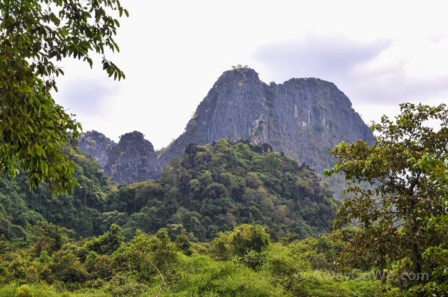 karst peeks surrounded by jungle near buddha cave in laos