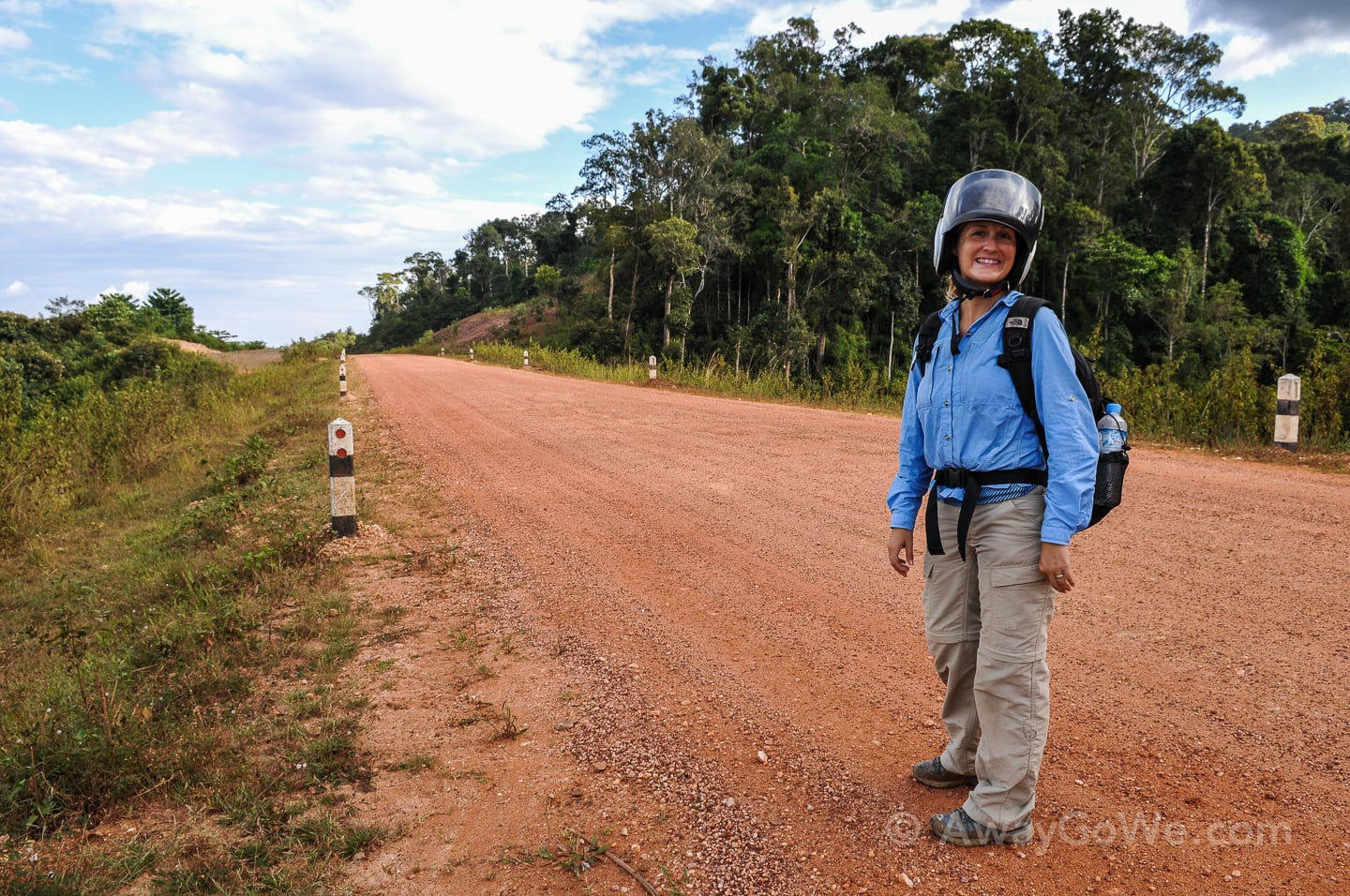 standing on gravel road on the thakhek loop in laos