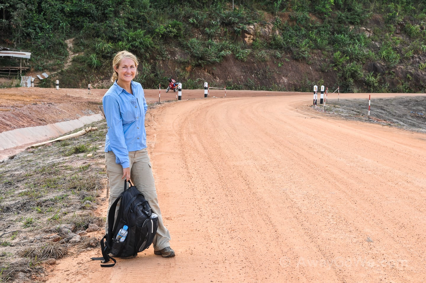 standing along unsealed road on the thakhek loop in laos