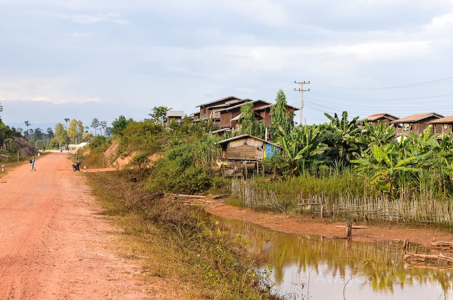 dirt road into a small village in laos