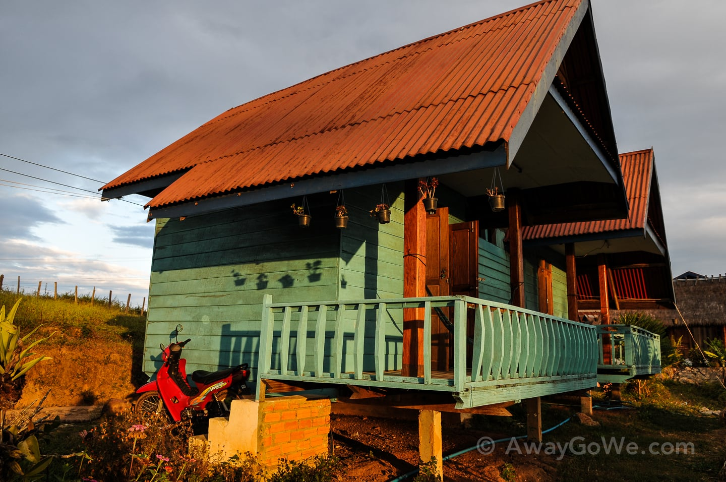 motorbike near wooden bungalow on thakhek loop in laos