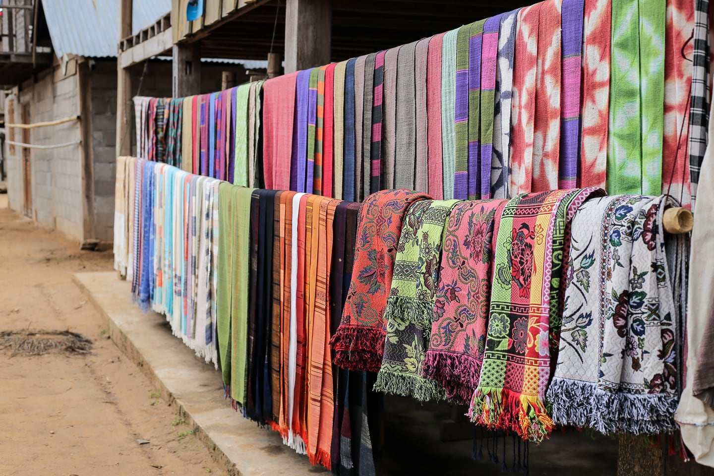 colorful Lao textiles on display in Sop Cham village