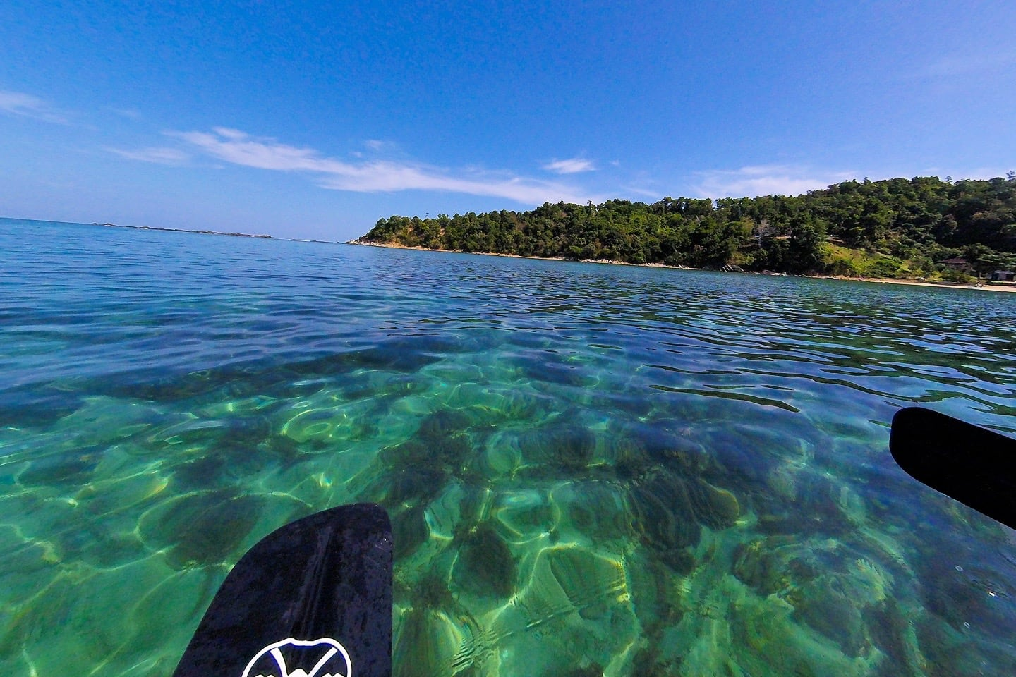 crystal clear water kayaking to Pandan Pandan Island (Borneo)