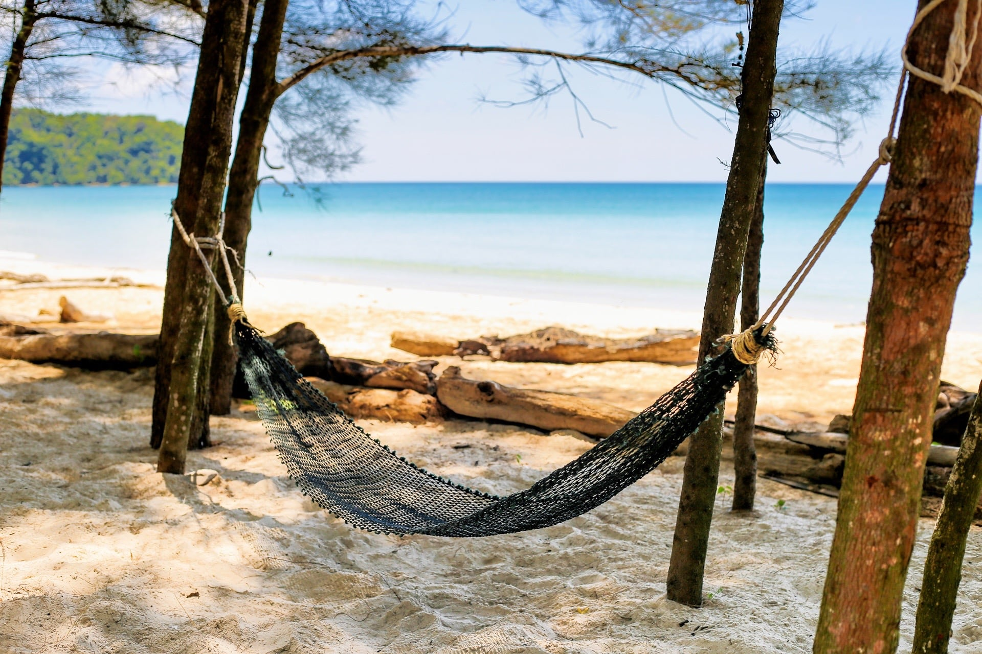 hammock between trees secret beach borneo