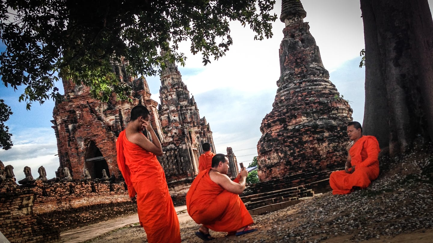 Buddhist monks at ancient temple of Ayutthaya on DIY tour