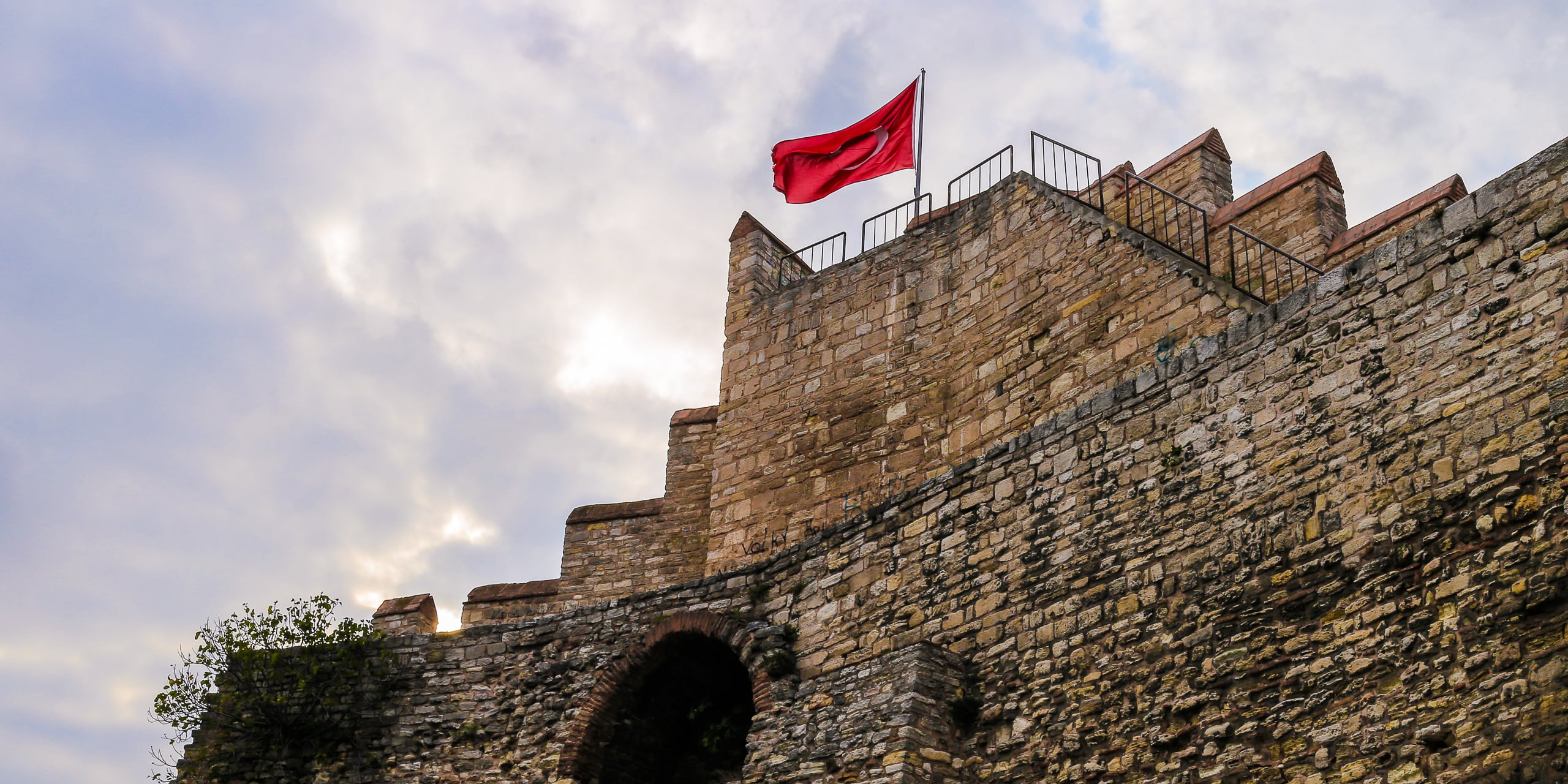 flag atop old rampart istanbul walls turkey