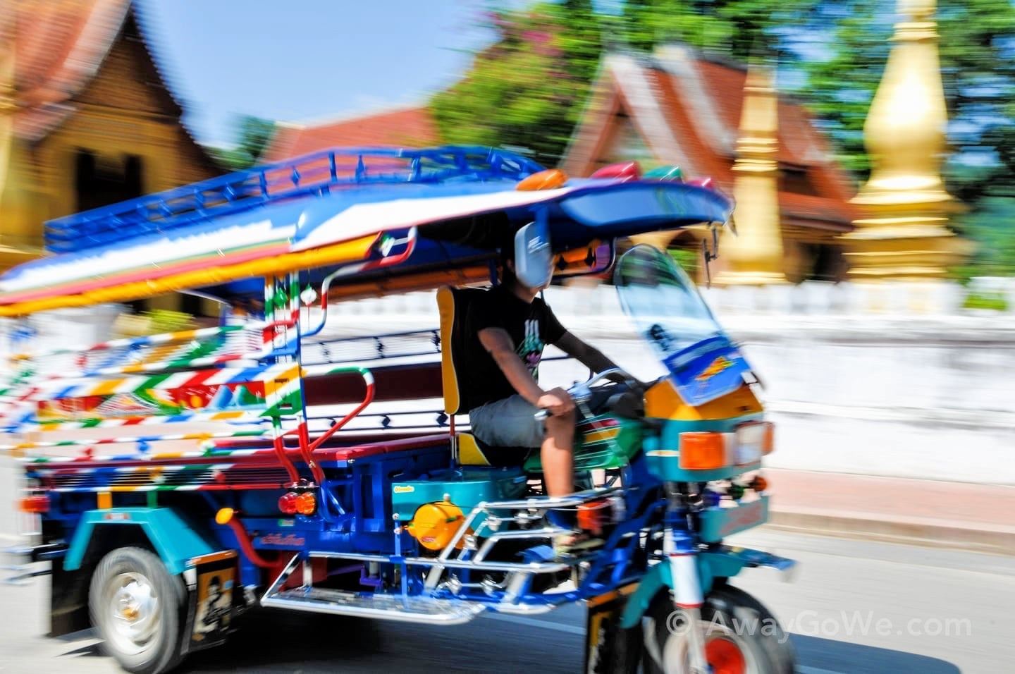 reasons to visit laos colorful tuk tuk