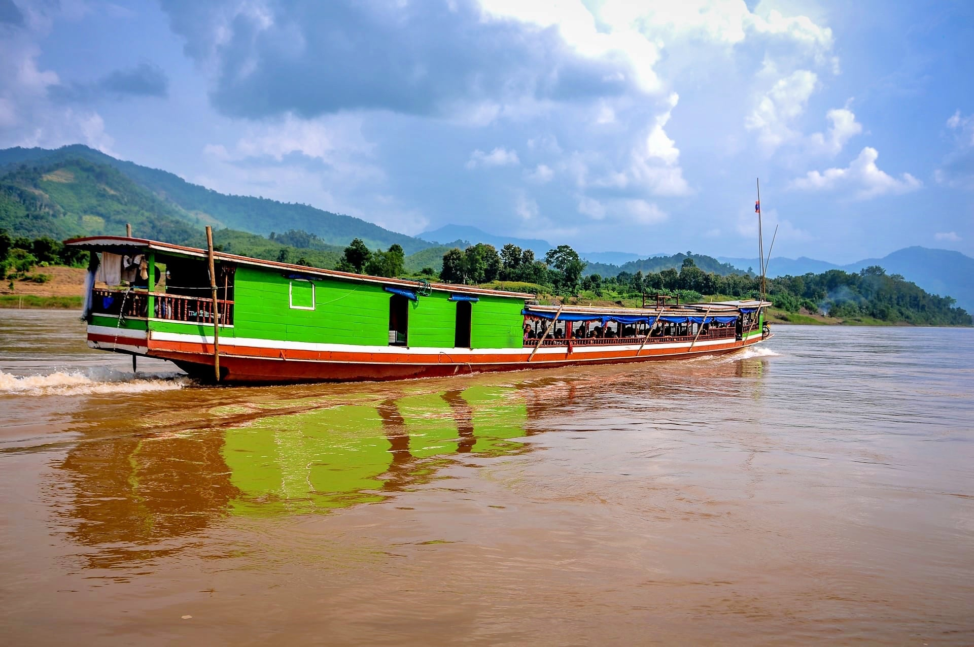 reasons to visit laos boat on mekong