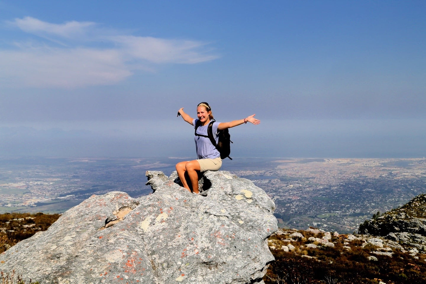 Hiker sitting on Table Mountain summit False Bay