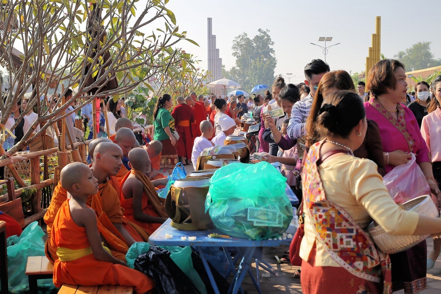 Buddhist monks receiving alms