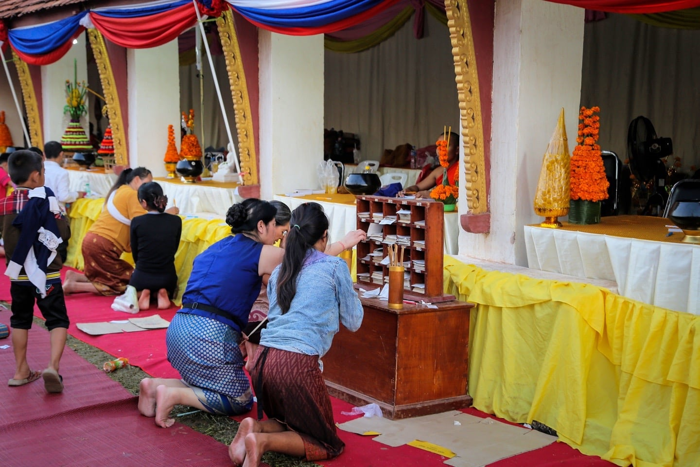 getting fortune read at Buddhist temple in Laos