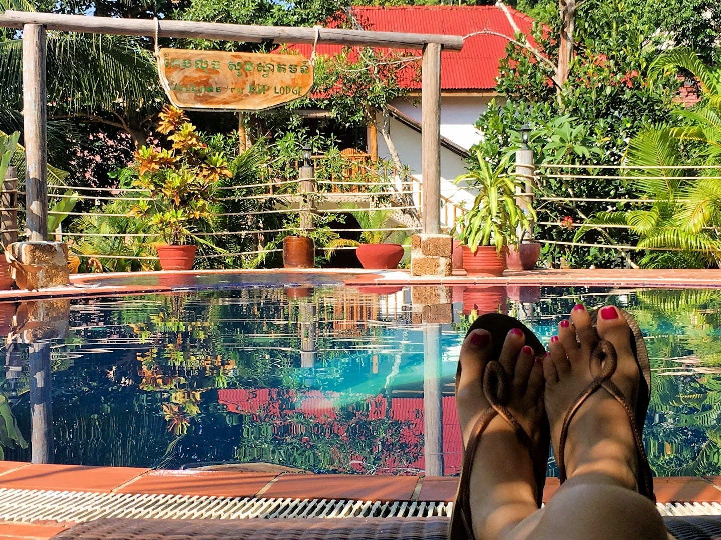 relaxing poolside at Kep Lodge Cambodia