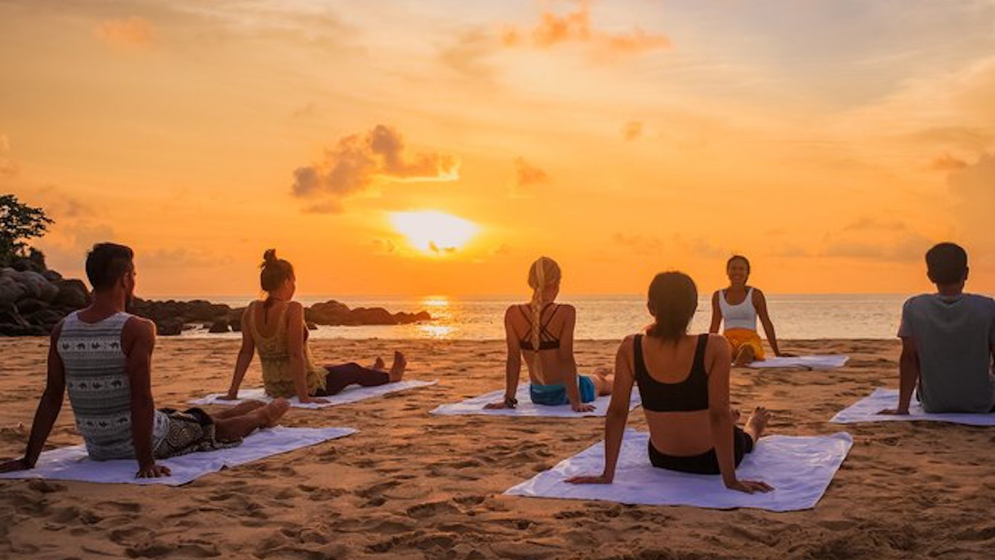 Sunrise yoga wellness retreat in Southeast Asia