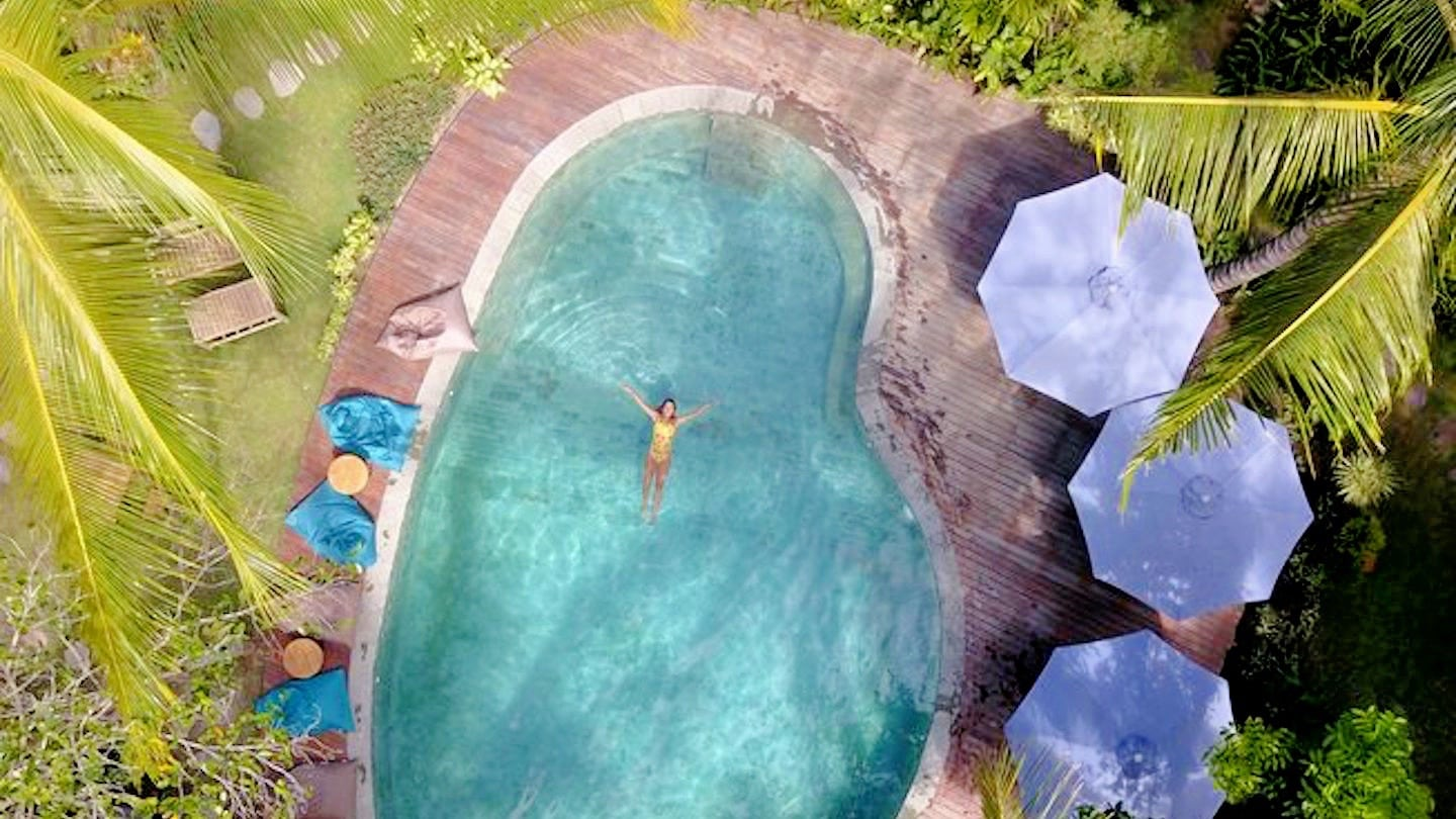 Best Yoga Retreats in Southeast Asia woman in pool