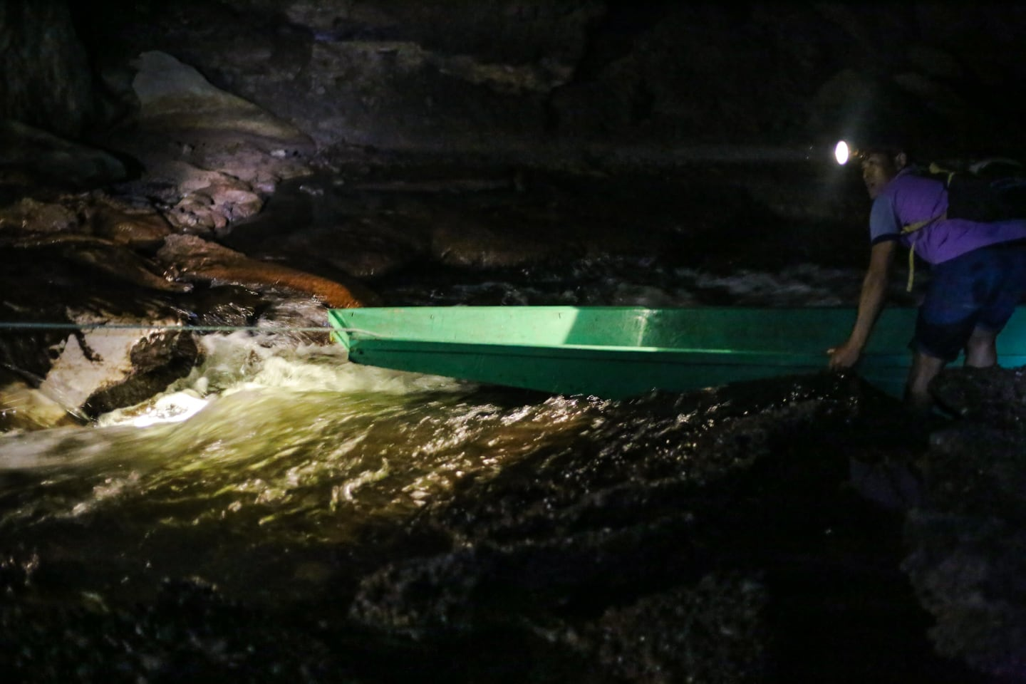 longtail boat in rapids Konglor Cave