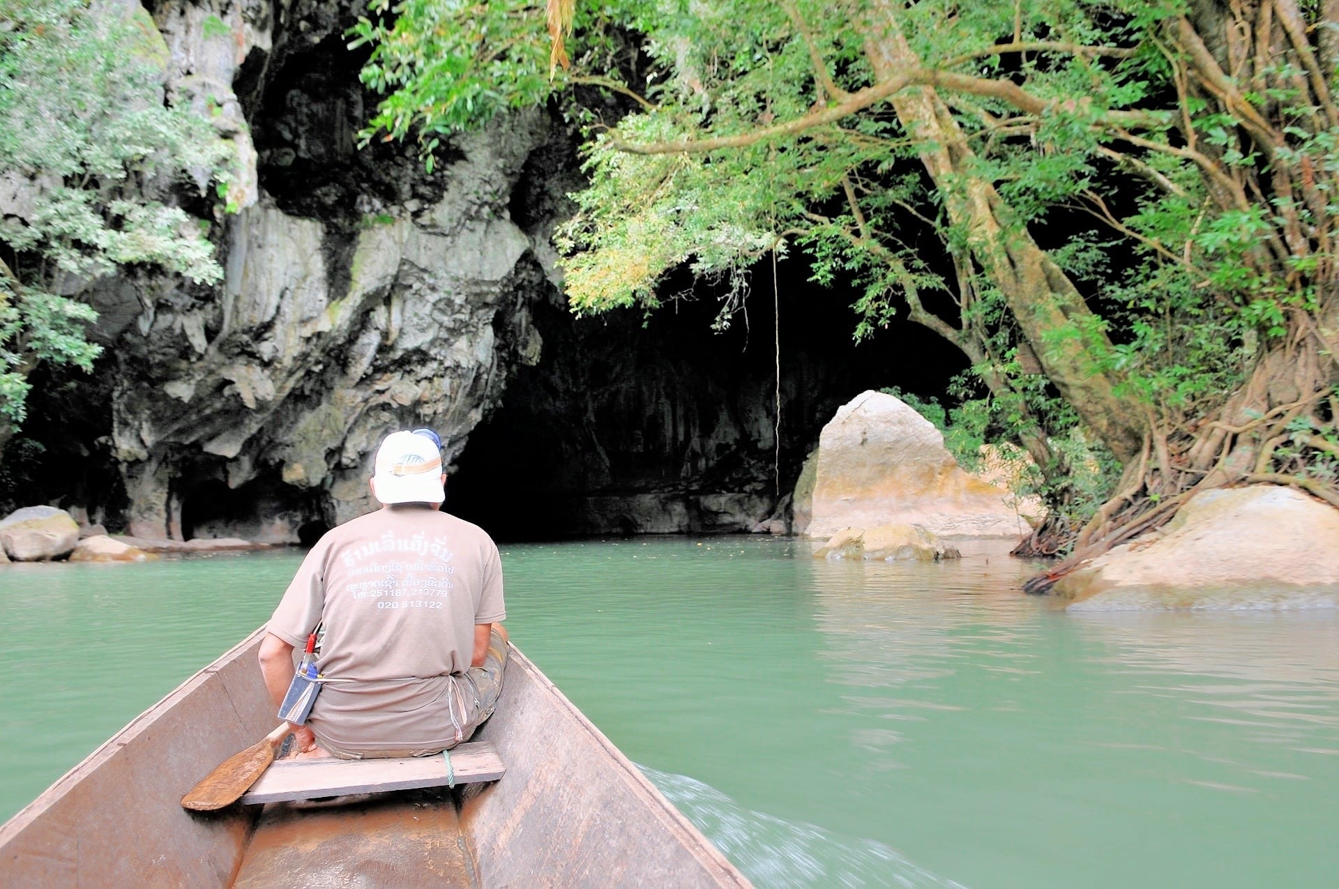 boat entering Konglor Cave Laos